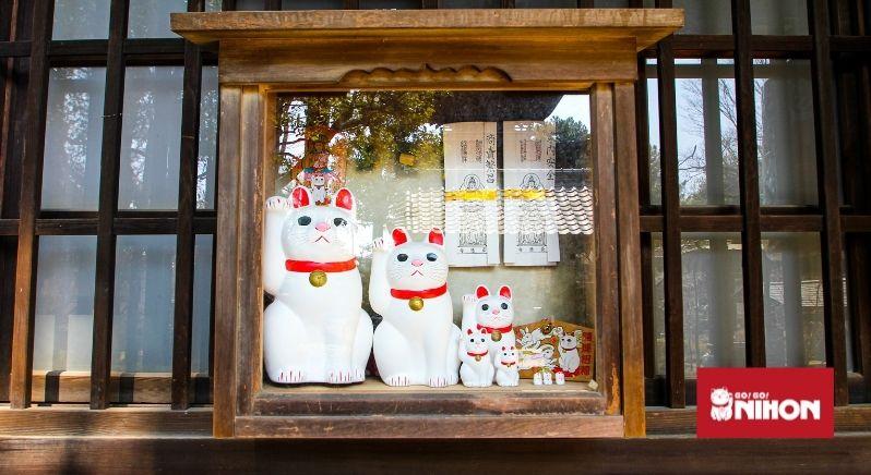 Maneki Neko lucky cat statues