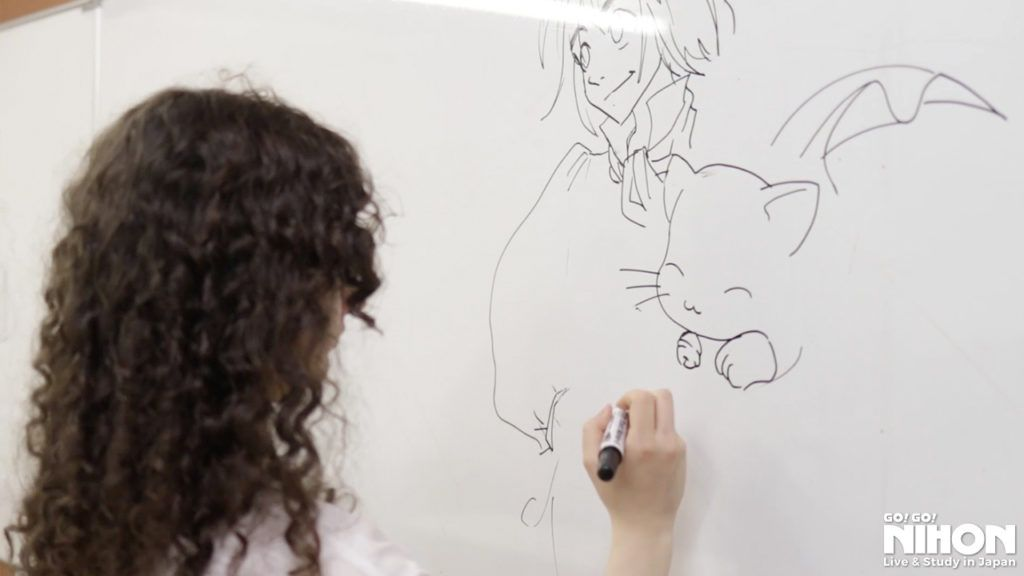 Mar drawing her manga characters