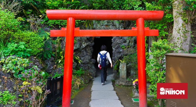 Woman walking through a torii gate