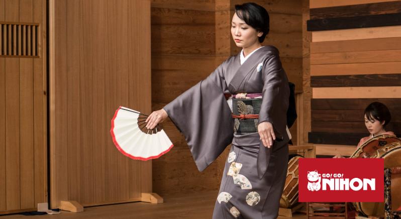 woman in kimono with fan