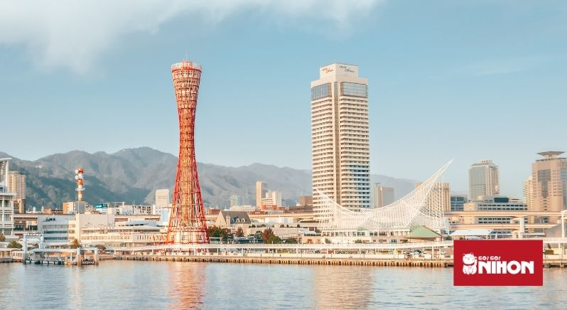 Kobe tower and seaside port with mountains in background