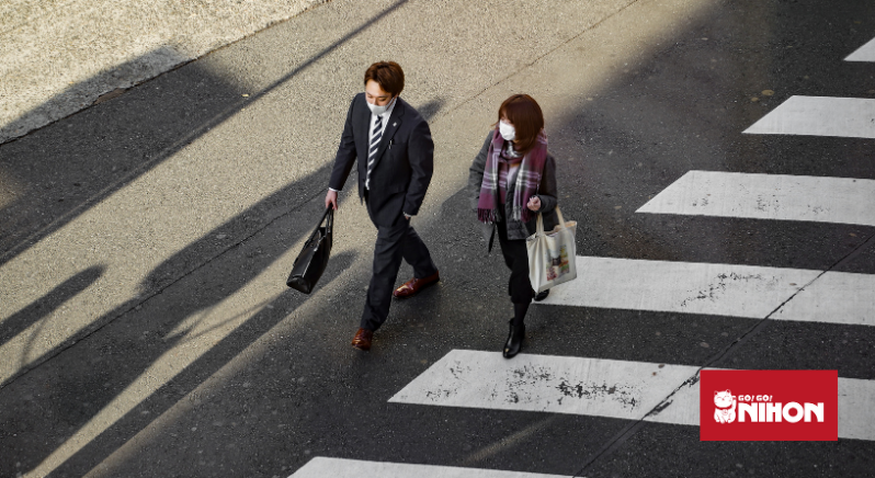 Two people crossing the road
