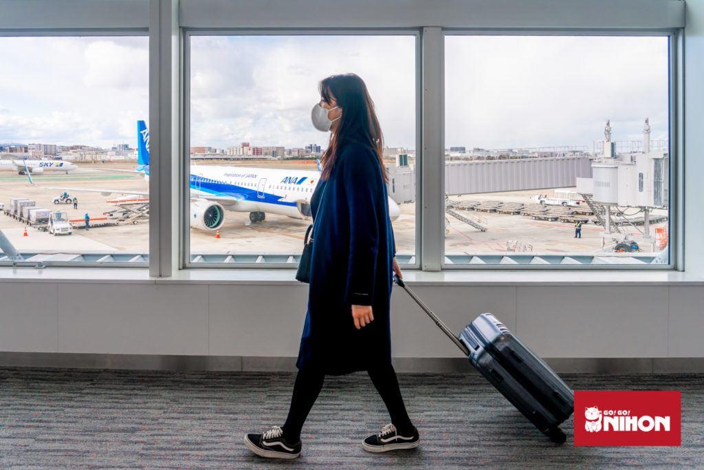 Passenger wearing mask at airport